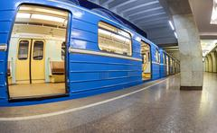 Blue subway train standing at the underground station. wide angle Kuvituskuvat