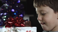 child opens Christmas gift - stock footage