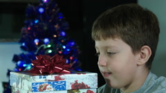 excited child opens christmas gift - stock footage