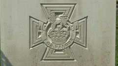 The Victoria Cross emblem on a grave in the Arnhem Oosterbeek War Cemetery. Stock Footage