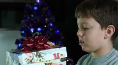 happy child opens a gift in christmas time - stock footage
