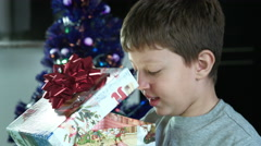 happy child opens a beautiful christmas gift in a box - stock footage