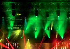 Bright beautiful rays of light on the concert stage Stock Photos