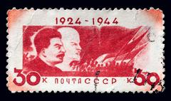 """ussr - circa 1944: a postage stamp printed in ussr shows """"lenin and stalin"""" , - stock photo"""