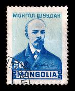 mongolia - circa 1953: a stamp printed in the mongolia shows young vladimir u - stock photo