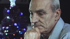 Depressed man during christmas time: holiday, loneliness, sadness Stock Footage