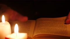Reading book in darkness . Leaf through by hands 4k Stock Footage