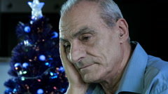 Depressed and sad man sitting alone on the nights of christmas holydays  Stock Footage
