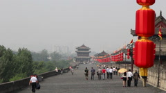 Tourists on Xian ancient city wall Stock Footage