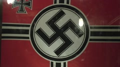 Nazi swastika flag on display in the Merville Battery, Lower Normandy, France. Stock Footage