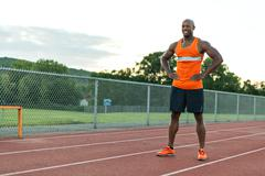 African american man in his 30s posing at a sports track outdoors. Stock Photos