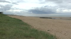 View west along Juno beach from Courseulles, Normandy, France. Stock Footage