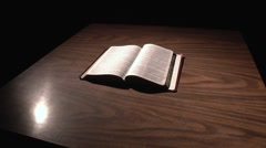 Bible on Table - Jib Shot Dollying Left and Pedestal Down - 720p - stock footage