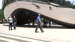 Cloud Gate at Millennium Park, Chicago, Bean- Man Walking Past Stock Footage