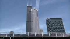 Stock Video Footage of Willis (Sears) Tower Chicago - Low Angle Passing Under Bridge - 720p