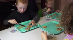 Grandchildren and cookies, decorating cookies Arkistovideo