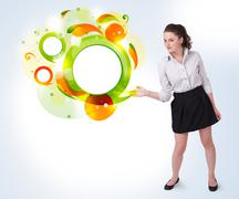 Young business woman presenting abstract copyspace - stock photo