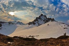 Sunset in mountain Stock Photos