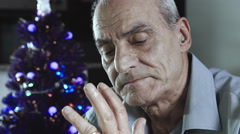 sad and lonely man remember his wife in the christmas time: depression, sadness - stock footage