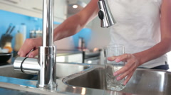 Young women filling the glass with water - stock footage