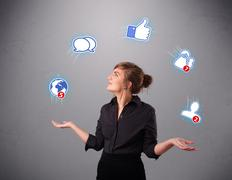 Attractive young woman juggling with social network icons Stock Photos