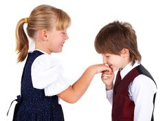 Little boy kissing hand Stock Photos
