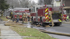 Stock Video Footage of Fire Crews at the Scene of a House Fire (4 of 5)