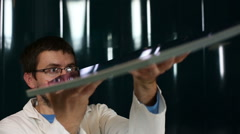 Male scientist performing an experimental research Stock Footage