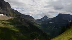 Glacier National Park - Clouds/Sun 1080p Stock Footage