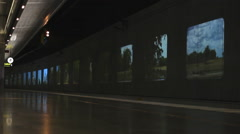 Moving pictures on the wall Train metro Underground  station Stock Footage
