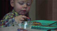 Grandchildren and cookies, small boy Arkistovideo