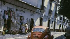 Mexico 1973: view from the window of a car driving in a small town - stock footage