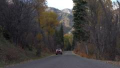 Red pickup truck scenic autumn mountain road 4K 054 Stock Footage