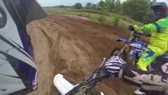 Dirt bike helmet cam passes rider on mx racetrack Stock Footage