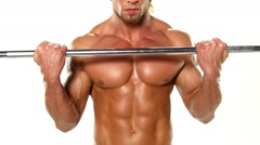 Close up young muscular man bodybuilder with a bar exercises the biceps, Stock Footage