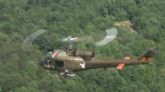 Huey Gunship flying in an aerial shot Stock Footage