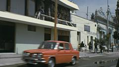 Mexico 1973: view from the window of a car driving in a small town Stock Footage