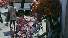 Mexico city 1973: children selling flowers in the street Stock Footage