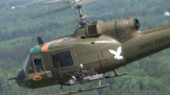Huey Gunship pull to 2nd helicopter Stock Footage