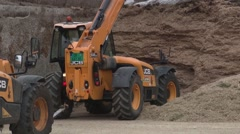 Excavators working on a dairy farm manure loaded Stock Footage