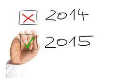 Man ticking the start of the 2015 new year Kuvituskuvat