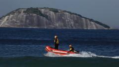 Rio de Janeiro: Lifeguards on Motor Life Boat Speed Down on Ipanema Beach Stock Footage