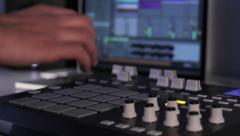DJ using his Drum Machine Stock Footage