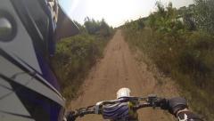 Dirt bike helmet cam over rough sandy terrain Stock Footage
