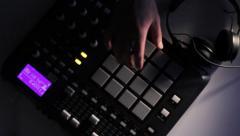DJ using his Drum Machine - stock footage