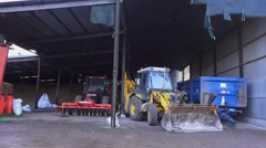 Farming barn shed tractor trailer and equipment parked Arkistovideo