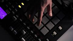 Stock Video Footage of DJ using his Drum Machine