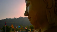 Golden Buddha and the light of the sun. Stock Footage
