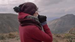 Female trekker using google glasses - stock footage
