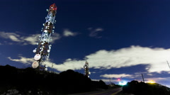 4K communication tower site at night with stars timelapse Stock Footage